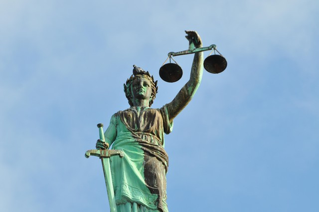 A statue of Lady Justice stand outside a courthouse in the U.S.