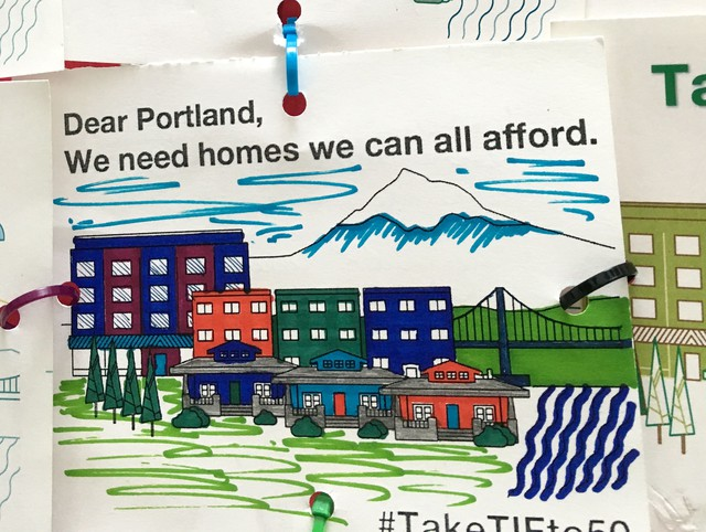 Activists with the Welcome Home Coalition delivered postcards to Portland City Council.