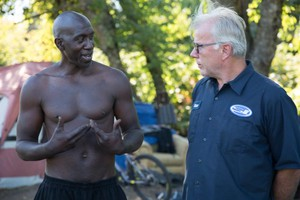 """Steve Spinnett talks with Otis """"Diamond"""" Britton, a homeless man who lives on the Springwater Corridor Trail. Spinnett and Britton have become friends."""