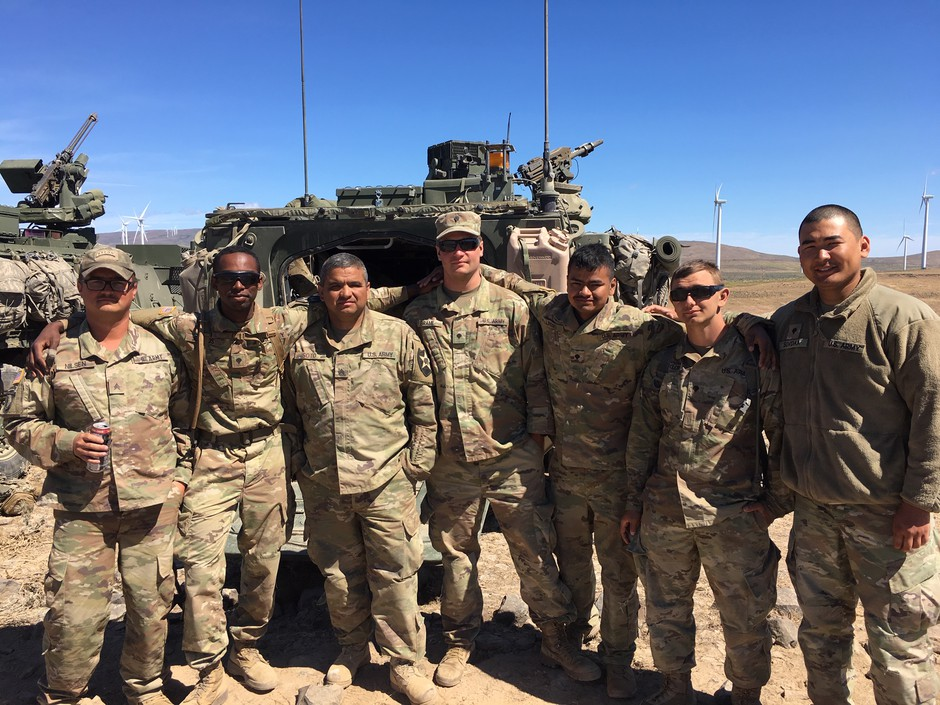 Spc. Joshua Junious, second from left, poses with members of his National Guard platoon at the Yakima Training Center..