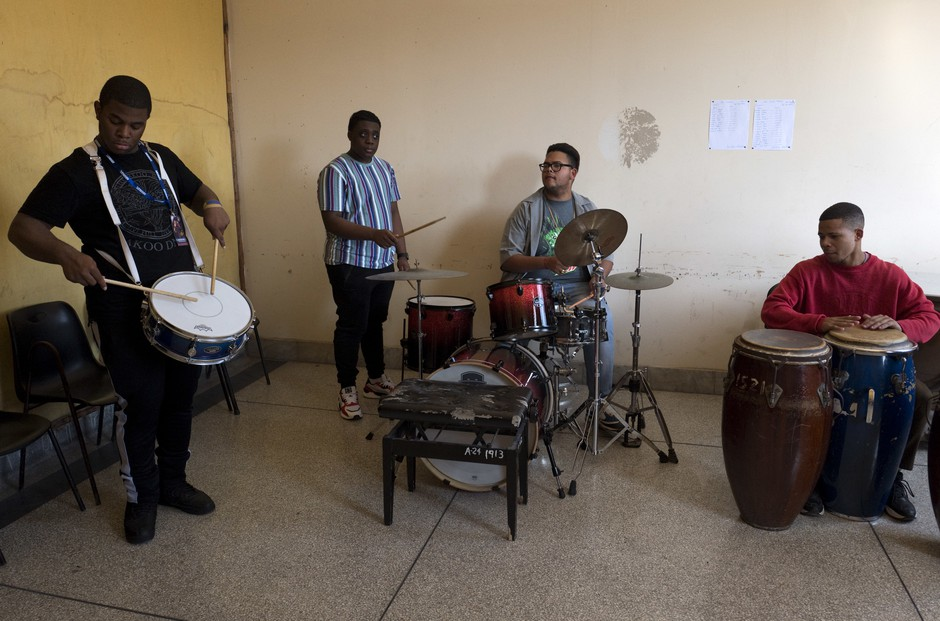 American musicians Darnell Simms and Jason Williams (left) from the Trombone Shorty Foundation teach at the Amadeo Roldan Conservatory as Cuban students Landi Peña Gonzalez and Jonathan Mendoza Valle (right) play along.