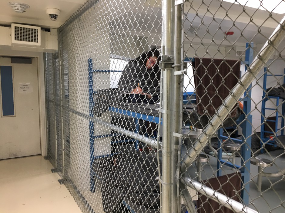 "Women inmates at the Mason County Jail in Shelton, Washington are held behind chain link fencing and given extra blankets to ward off the cold. One inmate said the nickname for the unit is the ""dog kennel."""