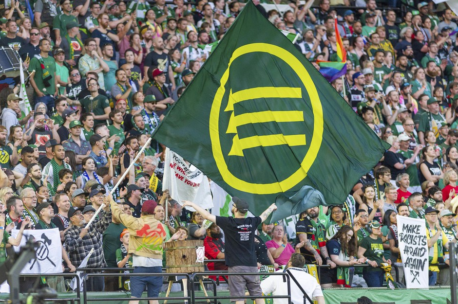 "At minute 33 of the first half, the Timbers Army supporters group break their silence and displays numerous flags and versions of the iron front symbol as they sing and old Italian Partisan song, ""Bella Ciao"", during the Seattle Sounders 2-1 victory over the Portland Timbers at Providence Park on August 23."