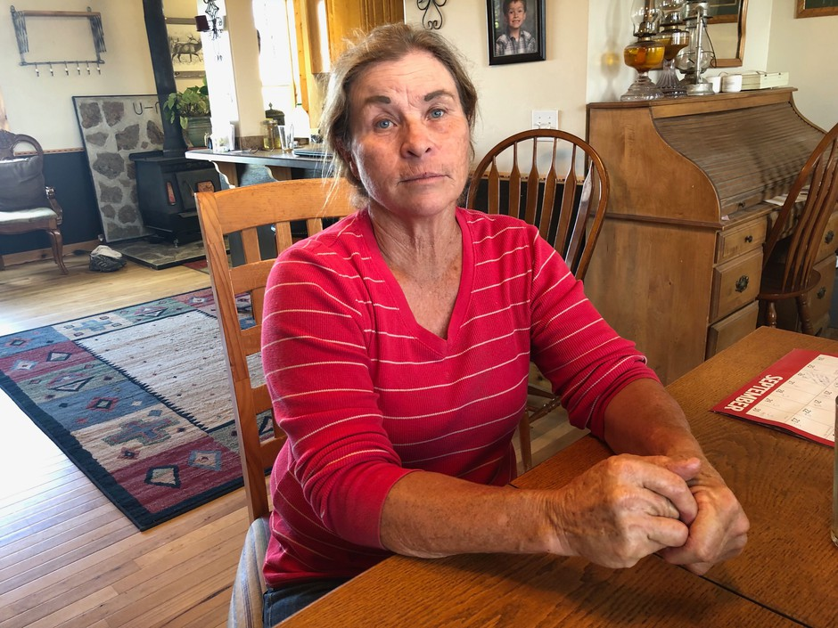 Andie Davies, of Princeton, Oregon, sits at her kitchen table taking a short break from canning chili peppers. Davies and her husband had one of their mother cows killed about two years ago in a mysterious way.