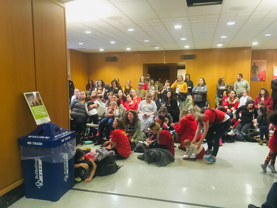 Opponents of a bill to eliminate non-medical vaccine exemptions watch a hearing on the bill in an overflow area at the Capitol in Salem, Ore., Thursday, Feb. 28, 2019.