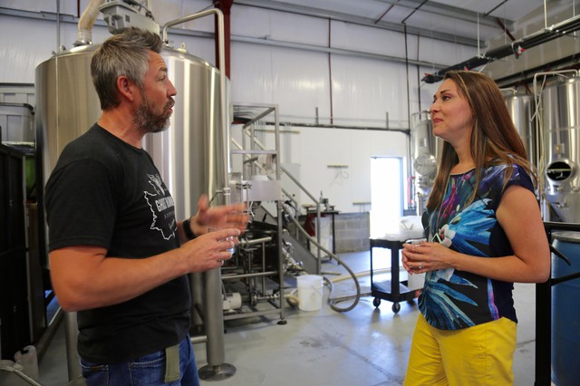 Rep. Jaime Herrera Beutler tours Vancouver's Ghost Runners Brewery with owner and founder Jeff Seibel in 2017.