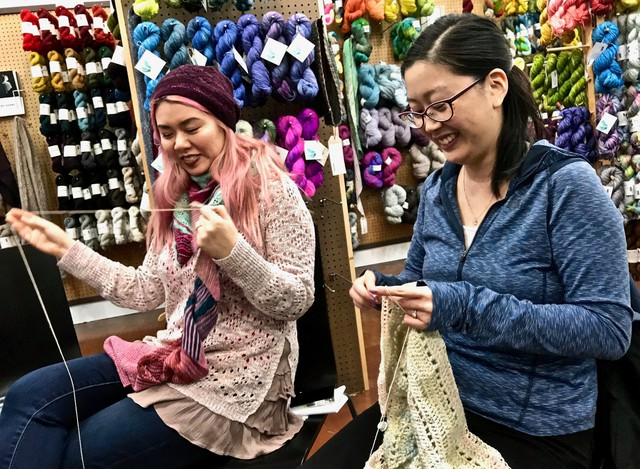 "During an advance Rose City Yarn Crawl event on Feb. 5, 2018, at Twisted yarn shop in Northeast Portland, Marilyn Hynes, right, works on her mystery crochet project, designed by her Seattle friend Noriko Ho, left. Hynes is following one of four ""clues,"" each a quarter of the pattern downloaded from the website Ravelry.com."