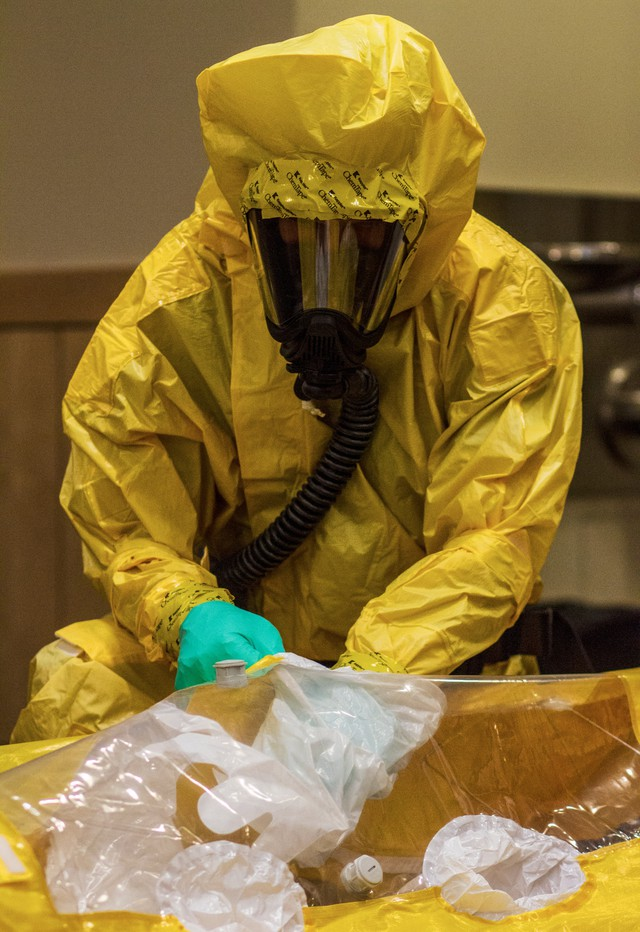 An employee with American Medical Services demonstrates how to use a Level B Ebola suit for members of the public on Thursday, October 24, 2014.