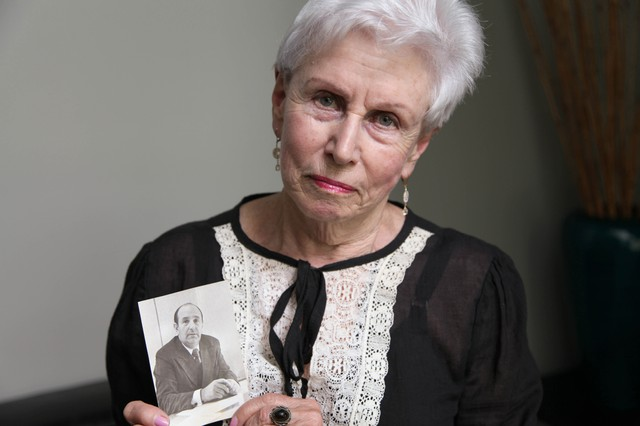 Yelena Benikov, a Ukrainian Jew, with a photo of her brother Aleksandr Vertman, who still lives in Ukraine.