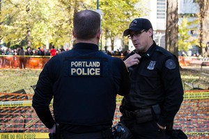 Portland police Lt. Jeff Niiya, right, with the police bureau's rapid response team at a protest in downtown Portland, Ore., Saturday, Nov. 17, 2018., 2018.