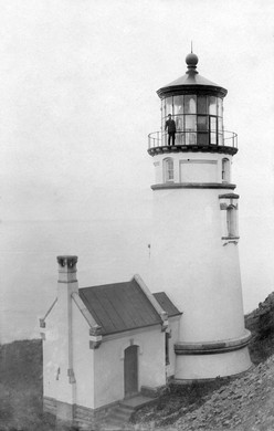 A lightkeeper stands atop the Heceta Head Lighthouse north of Florence, Ore., in an undated historical photo.