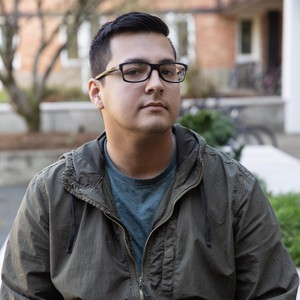At a University of Oregon residence hall, Isaiah De Alba said he is in favor of stricter immigration laws. He is against free higher education because he views the experience as an investment, and does not think all students would value the opportunity.