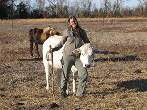 Janisse Ray with her cow, Emma, on her farm in Georgia. The writer gave up flying out of concern over carbon emissions and climate change.