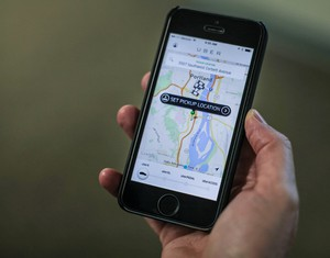 People can summon drivers from ride services like Uber through smartphone apps.