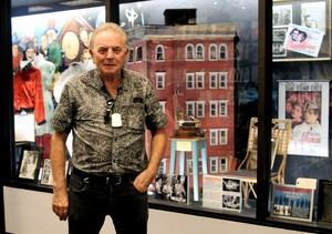 """""""I wanted the right people to take over Movie Madness and keep it the way I started it,"""" says owner Mike Clark, standing in front of one of his favorite items, the chair Ingrid Bergman sat in in """"Casablanca,"""" along with a building model used in """"Ghostbusters"""" and """"Blade Runner"""" and other memorabilia. """"I will live on because the store is who I am."""""""