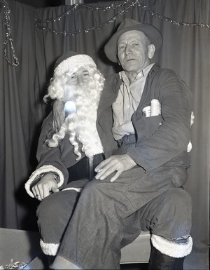 """A rejected Santa photo from the 1950s-1960s Oregon coast, curated by the Oregon Historical Society from a donated box labeled """"Santa photos not picked up."""""""