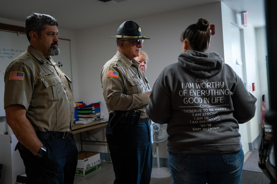 Coos County Sheriff Craig Zanni, center, speaks with Sheriff Department dispatchers on June 6, 2019, in Coquille, Ore.