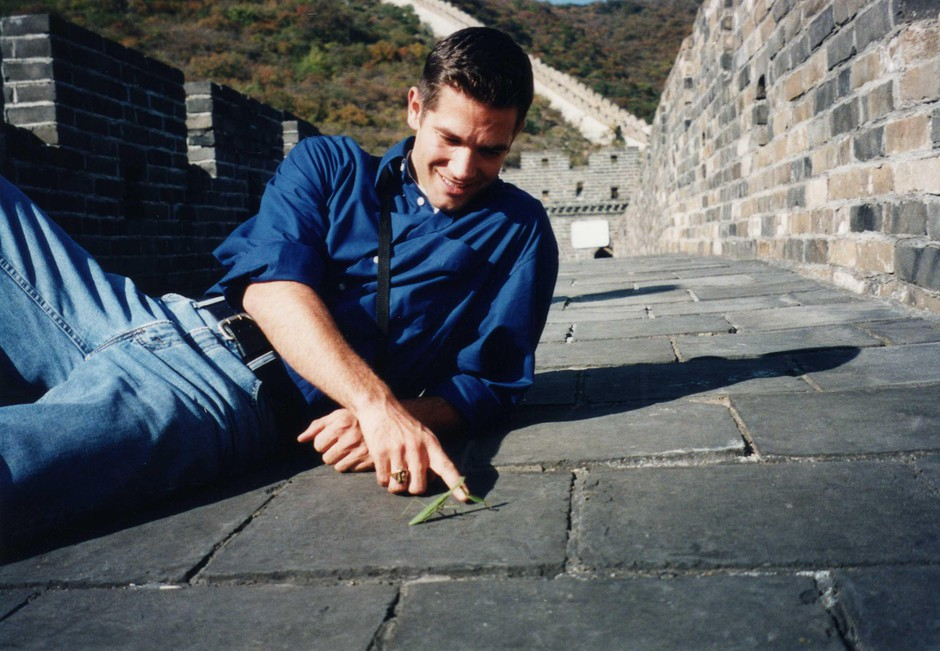 Christopher Marley with a mantis on the Great Wall of China. This was just one of the many insects Marley interacted with while traveling all around the world.