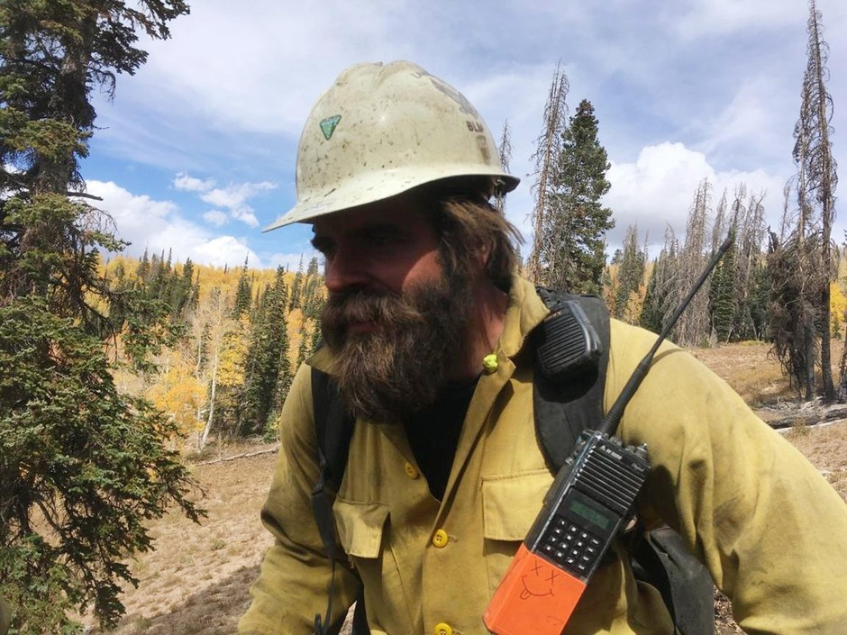 In this 2018 photo provided by Christopher Schott, Schott works in Utah with a firefighting crew out of Lakeview, Oregon.