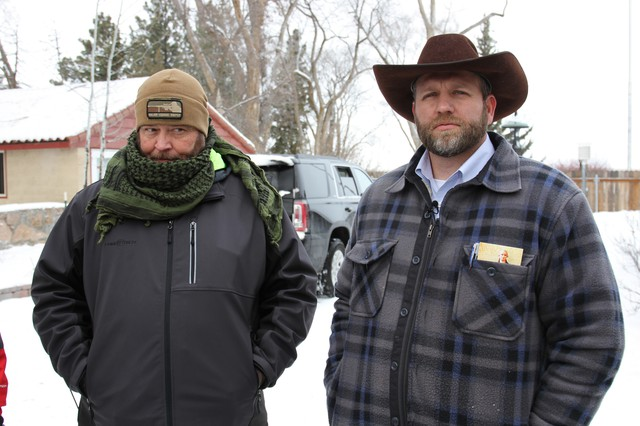Ammon Bundy (right) stands with a man who described himself as a guard of the Bundy family at the occupied headquarters of the wildlife refuge.