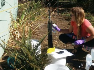 Paige Evans, with the Oregon Department of Environmental Quality, samples a well on the state's north coast.