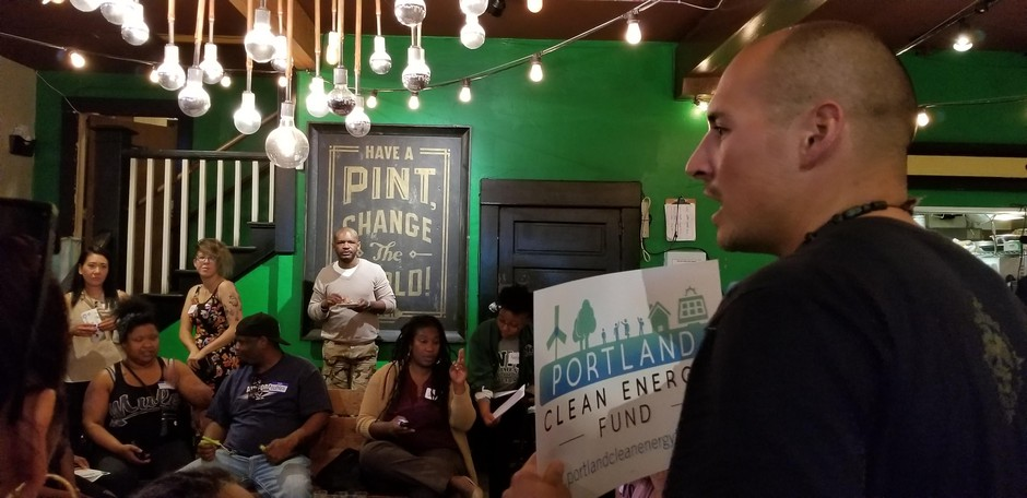 A supporter of Portland Clean Energy Fund speaks to the crowd at Brown Hope's Reparation Power Hour.