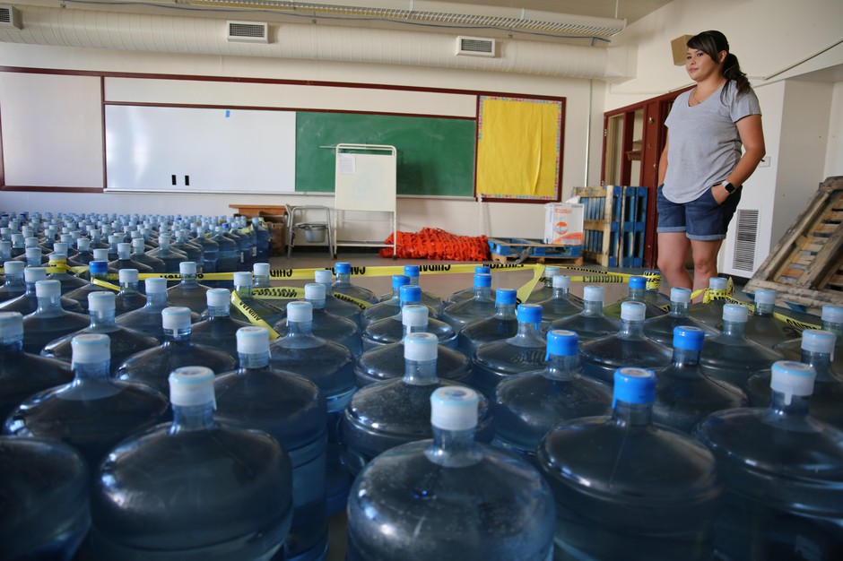 Volunteer Emergency Manager Dorothea Thurby of Warm Springs takes inventory of bottled water Aug. 2, 2019.