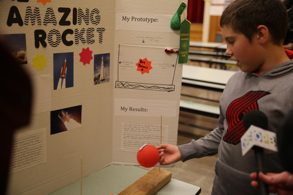 Class Of 2025 student Dale explains his fourth grade science fair project at Earl Boyles Elementary school. Dale said he set up the project more than fifty times to get it work perfectly.