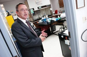 Oregon State Police crime lab director out of Pendleton, Keith Kerr, gestures while talking about the chemistry testing area at the Pendleton crime lab in Aug. 2011.