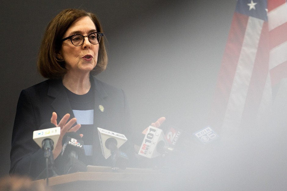 Gov. Kate Brown speaks at a press conference on March 16. Brown announced she is closing the state's bars and restaurants and banning gatherings of more than 25 people.