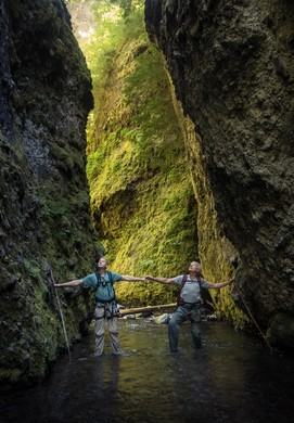 A slot canyon is casually defined as more narrow than tall. Sean Malone, left, and Mike Malone, right, stand at a point in the canyon where it is only two arm spans wide.