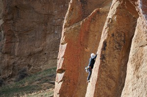 A person scales a cliff at Smith Rock State Park in Terrebonne, Oregon. Smith Rock is a popular destination for rock climbers from all over the Northwest.