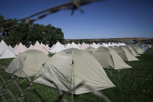 Rows of tents await Solarfest campers in Madras, Oregon.