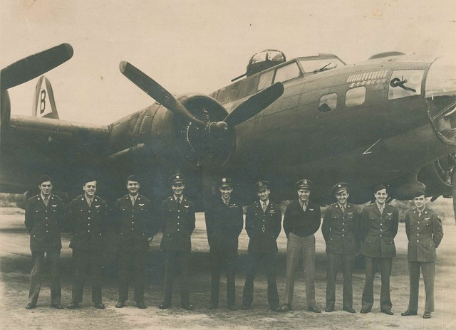 """Joe Ahearn, Sr. stands third from left in front of """"Ready Teddy,"""" a B-17 that was built in Seattle. Of the 210 men in the 92nd Bombardment group, only 15 survived."""