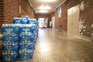 Cases of water bottles line the hallways at Rose City Park school in Portland, Oregon.