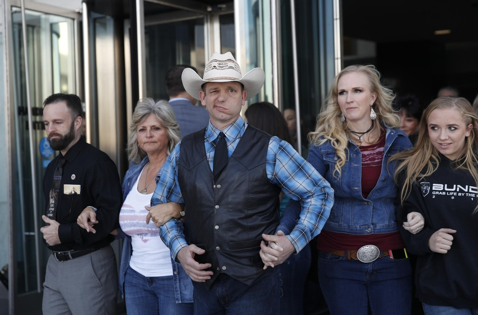 """From left, Ryan Payne, Jeanette Finicum, widow of Robert """"LaVoy"""" Finicum, Ryan Bundy, Angela Bundy, wife of Ryan Bundy and Jamie Bundy, daughter of Ryan Bundy, walk out of a federal courthouse, Dec. 20, 2017, in Las Vegas, Nevada."""