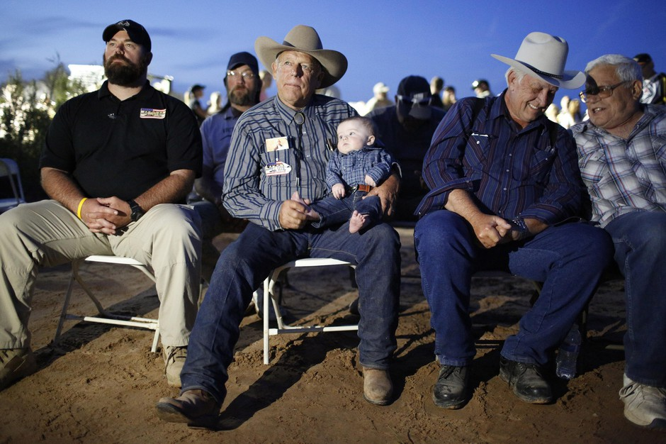 Rancher Cliven Bundy holds his grandson Roper Cox at an event April 11, 2015, in Bunkerville, Nev. Bundy was holding the event to celebrate the one year anniversary since the Bureau of Land Management's failed attempt to collect his cattle.