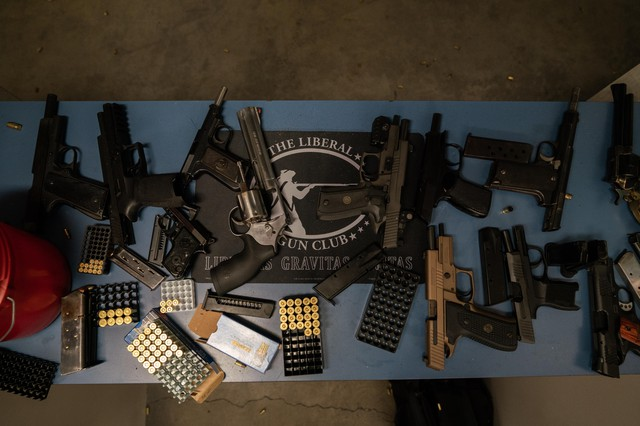 Guns are splayed out at the gun range during The Liberal Gun Club's winter range day on Jan. 26, 2019 in Portland, Ore.