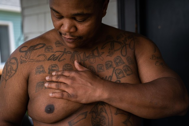 Lionel Irving shows his tattoos on July 1, 2019, in North Portland. Irving is trying to interrupt the cycle of violence in his community that led him to join a gang at a young age.