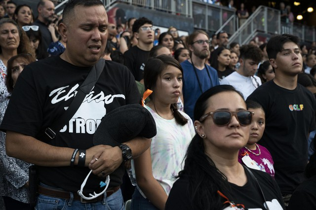 EL PASO, TX - AUGUST 14: Attendees listen to the invocation at a memorial for the 22 people killed in a mass shooting on August 14, 2019 in El Paso, Texas.