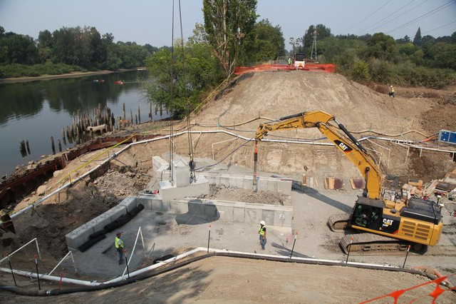 Construction crews install a new culvert that will make it easier for fish to travel between the Willamette River and the Oaks Bottom Wildlife Refuge. The 16-foot culvert will replace an old one that was only 5 feet in diameter.