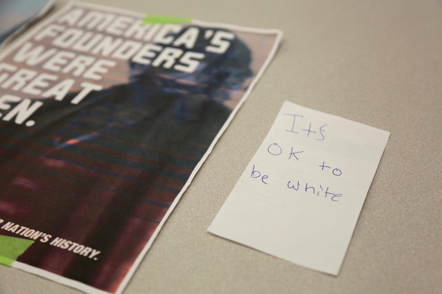 """File photo of posters reading """"It's OK To Be White,"""" posted in the fall of 2017 around the campus of Clark College, a community college in Vancouver, Washington."""