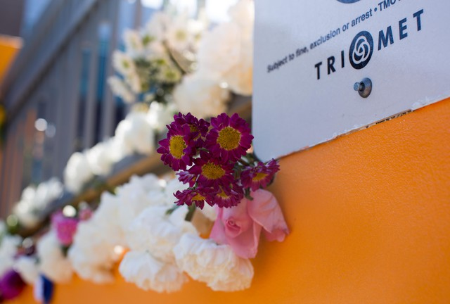 Flowers adorn the walkways and railings at the Hollywood Transit Center memorial Sunday, May 27, 2018, where a year earlier a makeshift memorial popped up in honor of those killed during a knife attack on a MAX train.