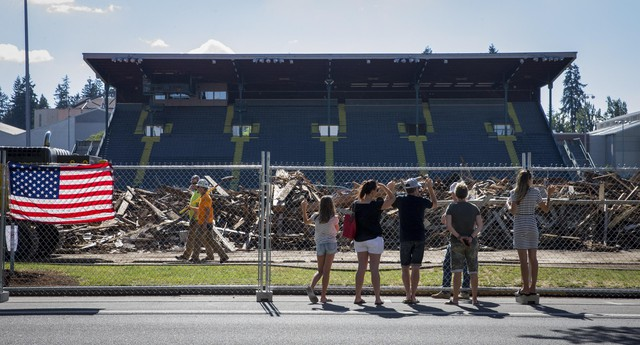 The Zadoff family from Portland watches the demolition of Historic Hayward Field's East Grandstand.