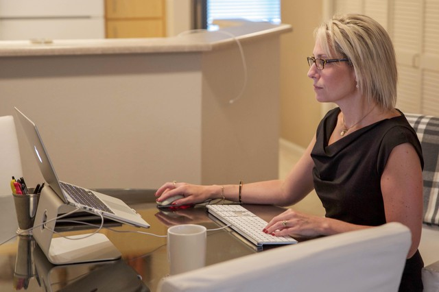 Susie Strangfield, formerchief information officer for Oregon Department of Education, in her apartment.