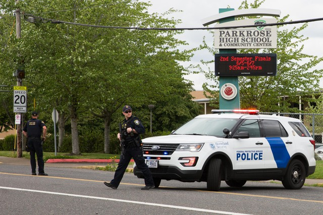 Portland police respond toreports of a person with a gun near Parkrose High School in Portland, Ore., on Friday, May 16, 2019.