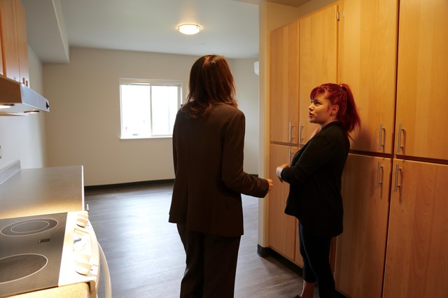 20-year-old Chistina LaCelle tours a studio apartment at Vancouver's new complex, Caples Terrace. The new subsidized housing caters to young people like LaCelle, who have aged out of foster care and are experiencing homelessness.