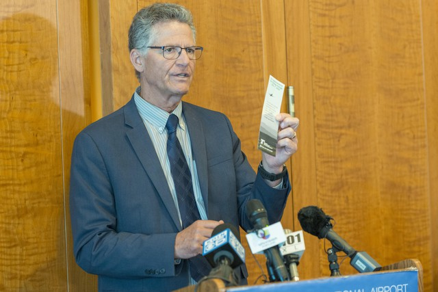 Oregon DOT Communications Manager Tom Fuller displays materials that provide information about Real ID.