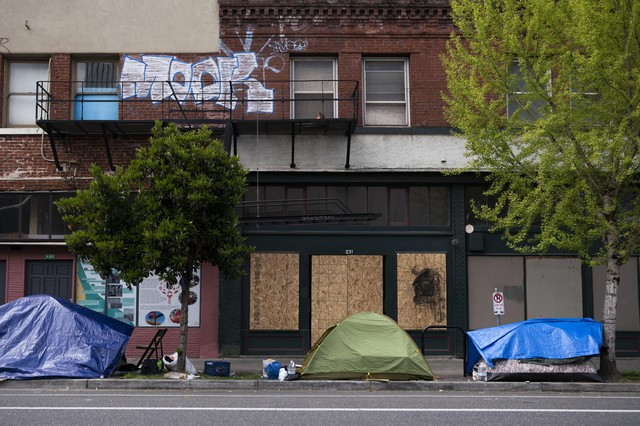 Tents line a street in front of boarded up shops on April 15, 2020, in downtown Portland. As businesses have closed and resources have moved online or over the phone, mental health treatment has also become more difficult to access for many in the unhoused community.