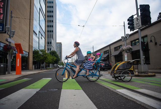 Annie Rudwick bikes to work with her daughters.